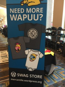 Sign at WordCamp US swag store reads Need more WAPUU?